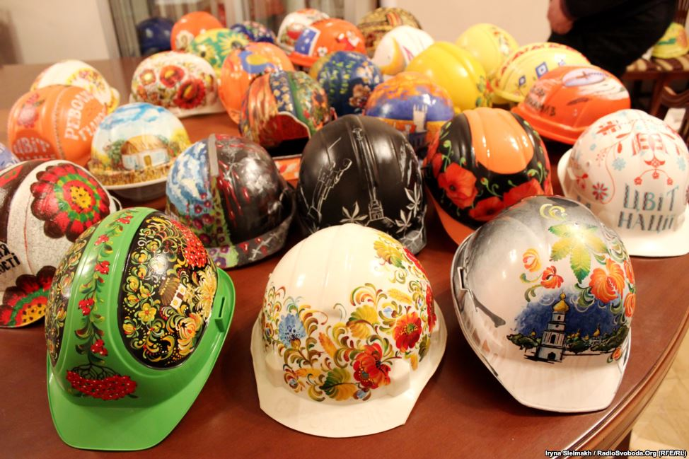 Some 100 painted helmets are on display at the Ukrainian House and the Kyiv city administration building, both controlled by antigovernment protesters.