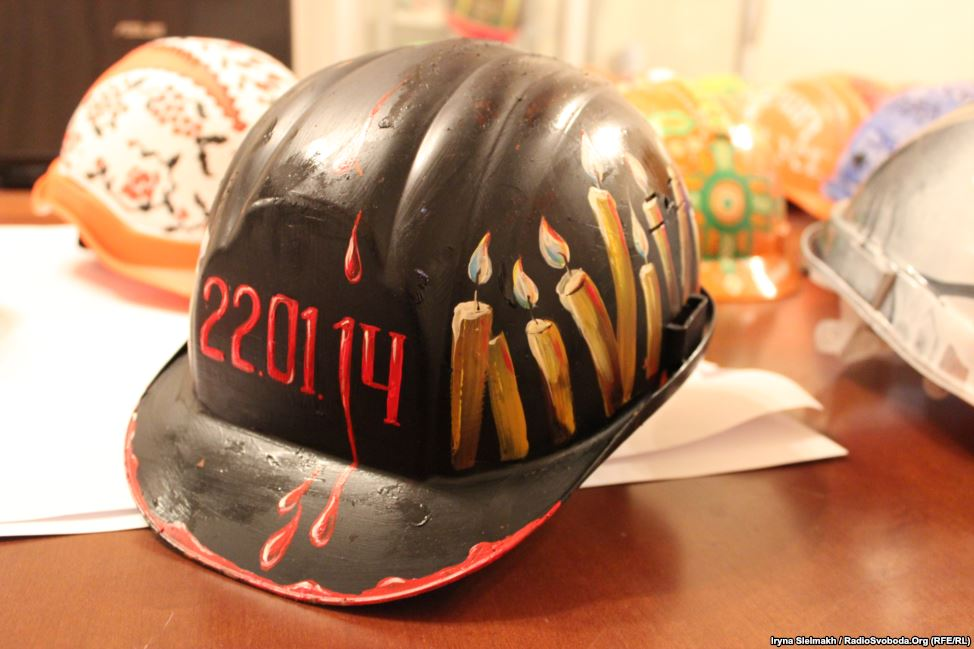 One helmet bears the date January 22, 2014, when at least three protesters died in clashes with police.
