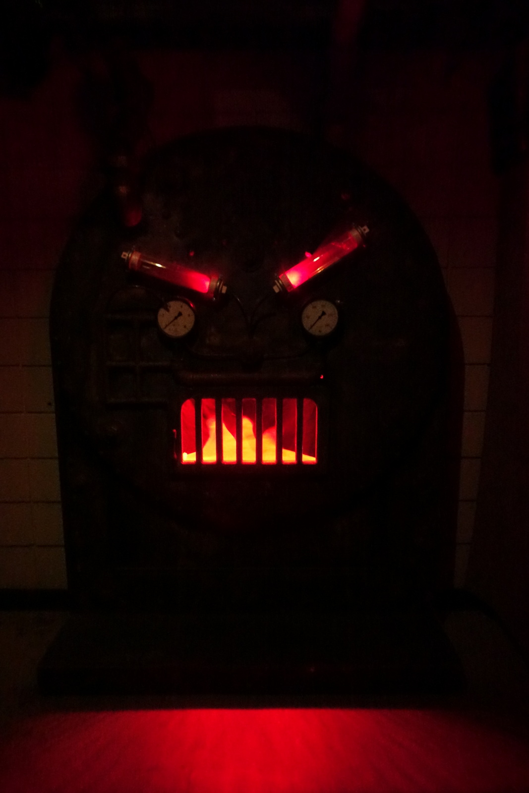 After stopping to observe a few rooms, you walk down a hallway to approach this furnace face.